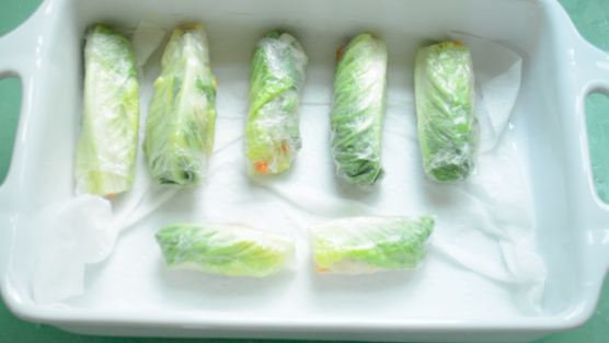Vegan Asian Spring Rolls on wet paper towel for storage